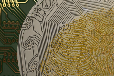 A gold-colored fingerprint on a silvery piece of circuit board
