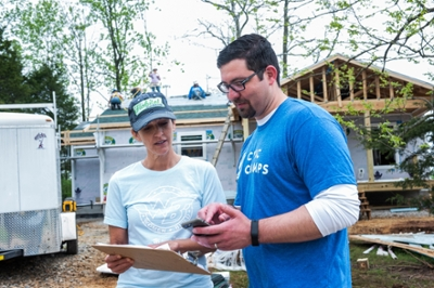 Ryan Underdahl shows his app to Wendi Goodlett of Habitat for Humanity of Monroe County.
