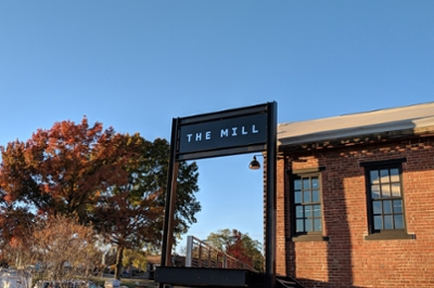 The entryway to The Mill, highlighted against a blue sky.