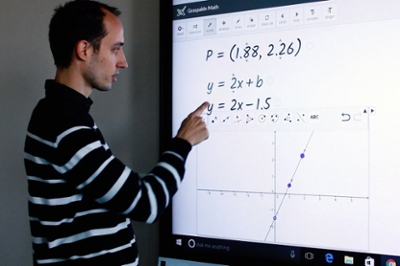 The Graspable inventor shows work on a whiteboard