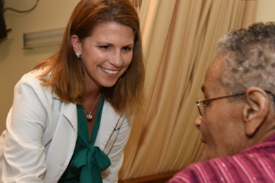 Dr. Kathleen Unroe speaks with a patient