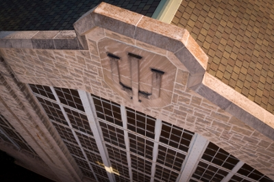 Scenic view looking down on a brick building with the IU trident in relief