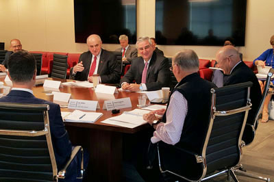IU President McRobbie, Gov. Holcomb, and others around a conference table